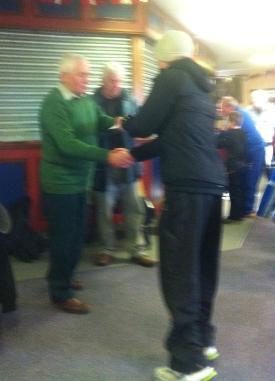 DD receiving his award from Jim Alder